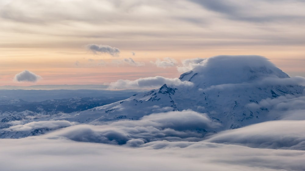 white mountain and clouds during daytime