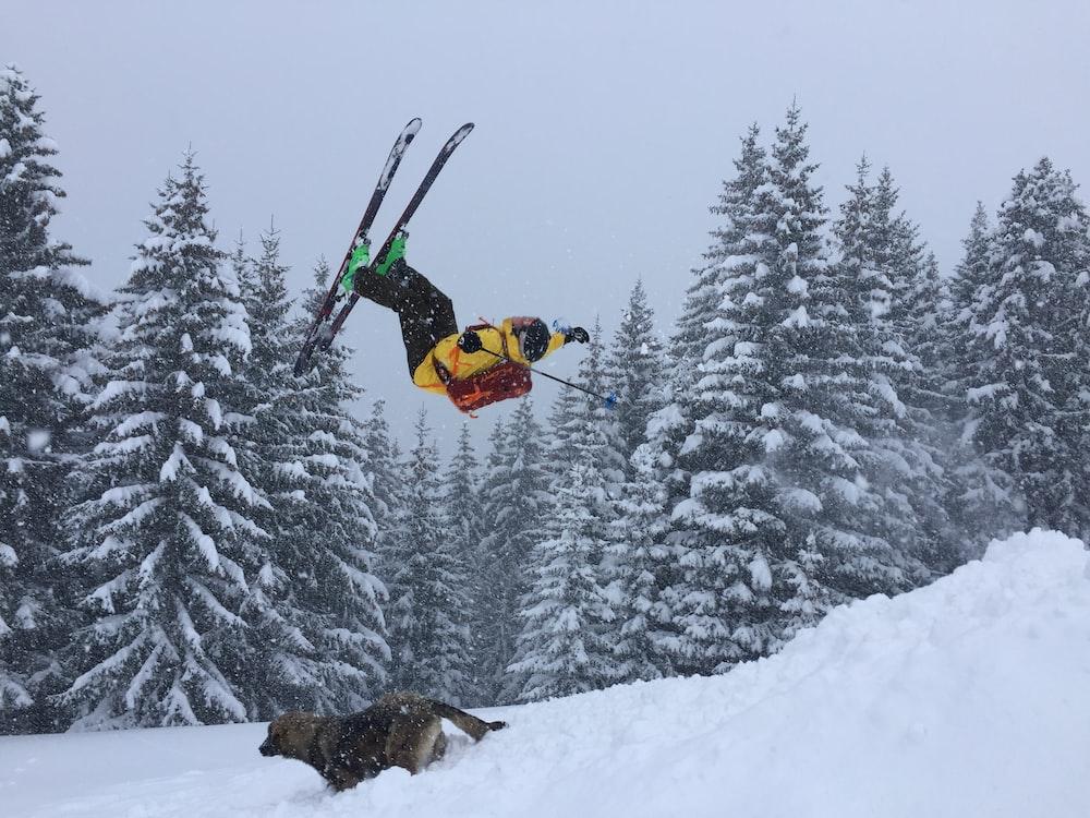 man ramping on ski blades on snow field