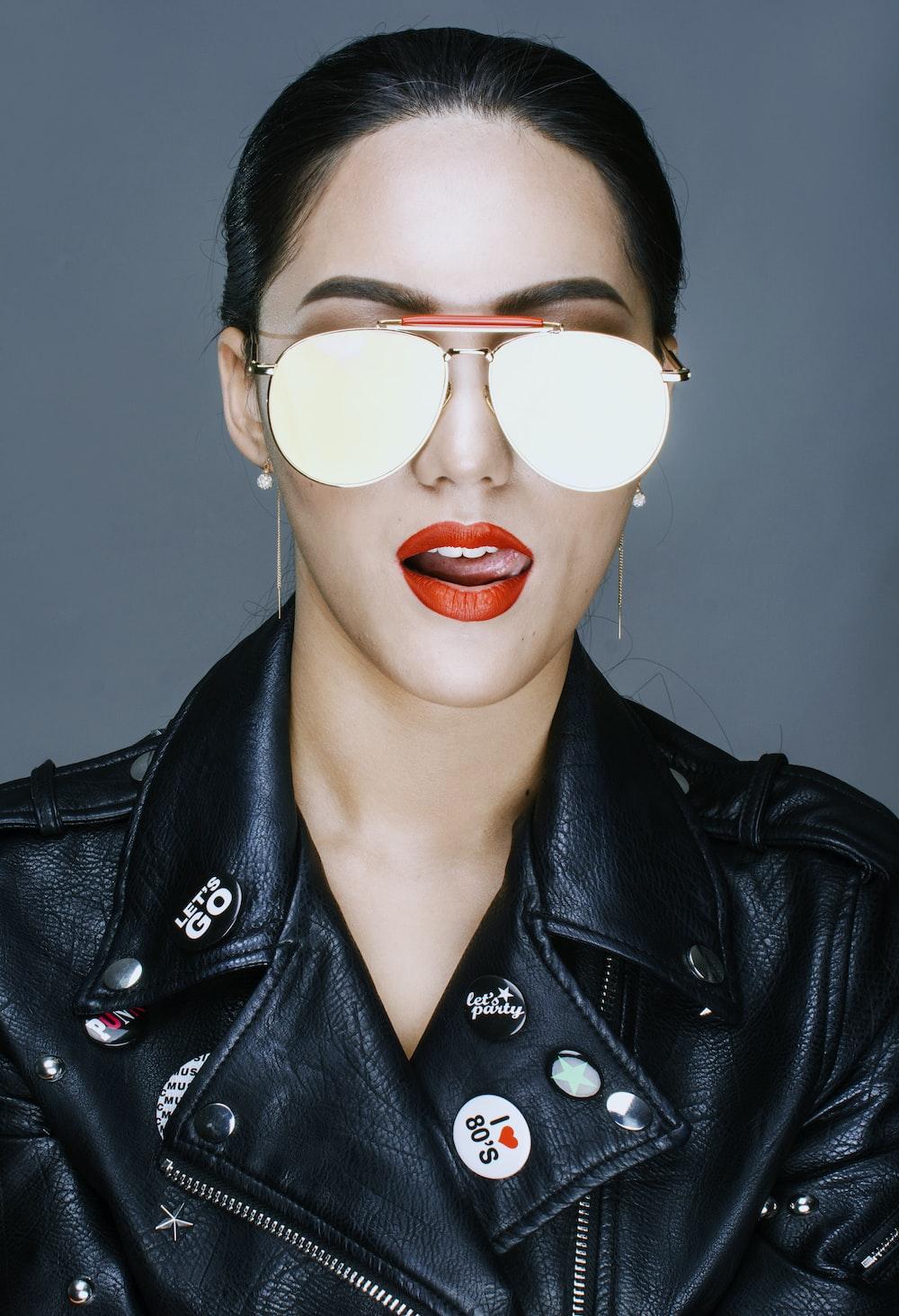 woman licking lips wearing black leather jacket
