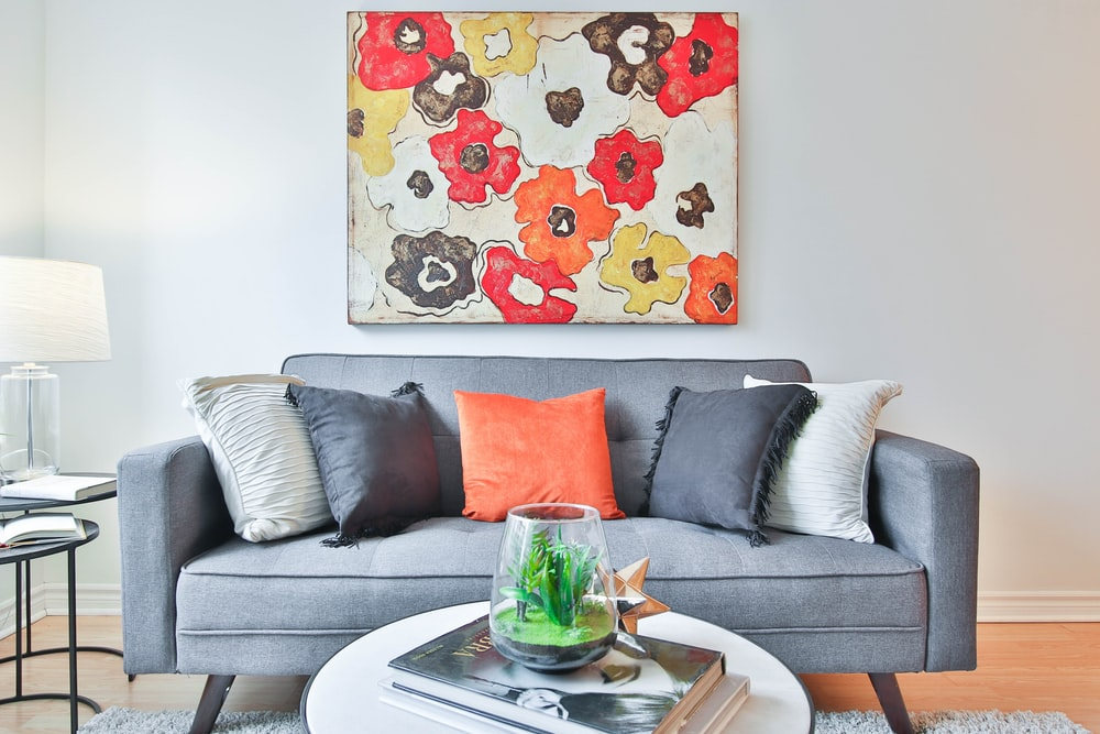 throw pillows on cushioned sofa by wall