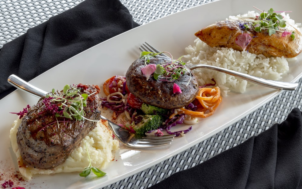 grilled meat with cooked rice and vegetables