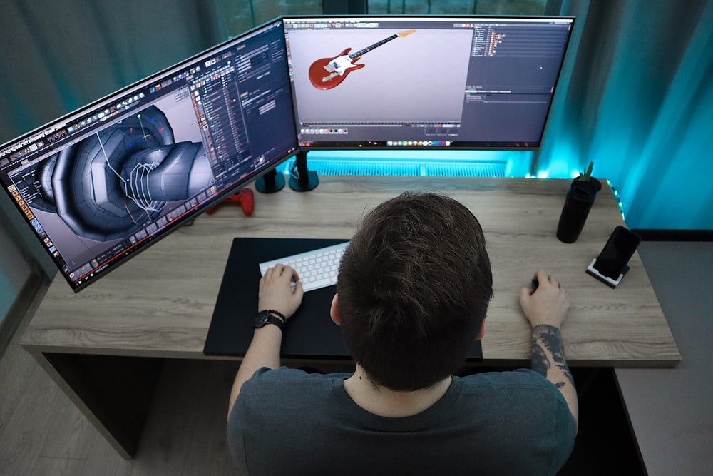 man sitting and using computer