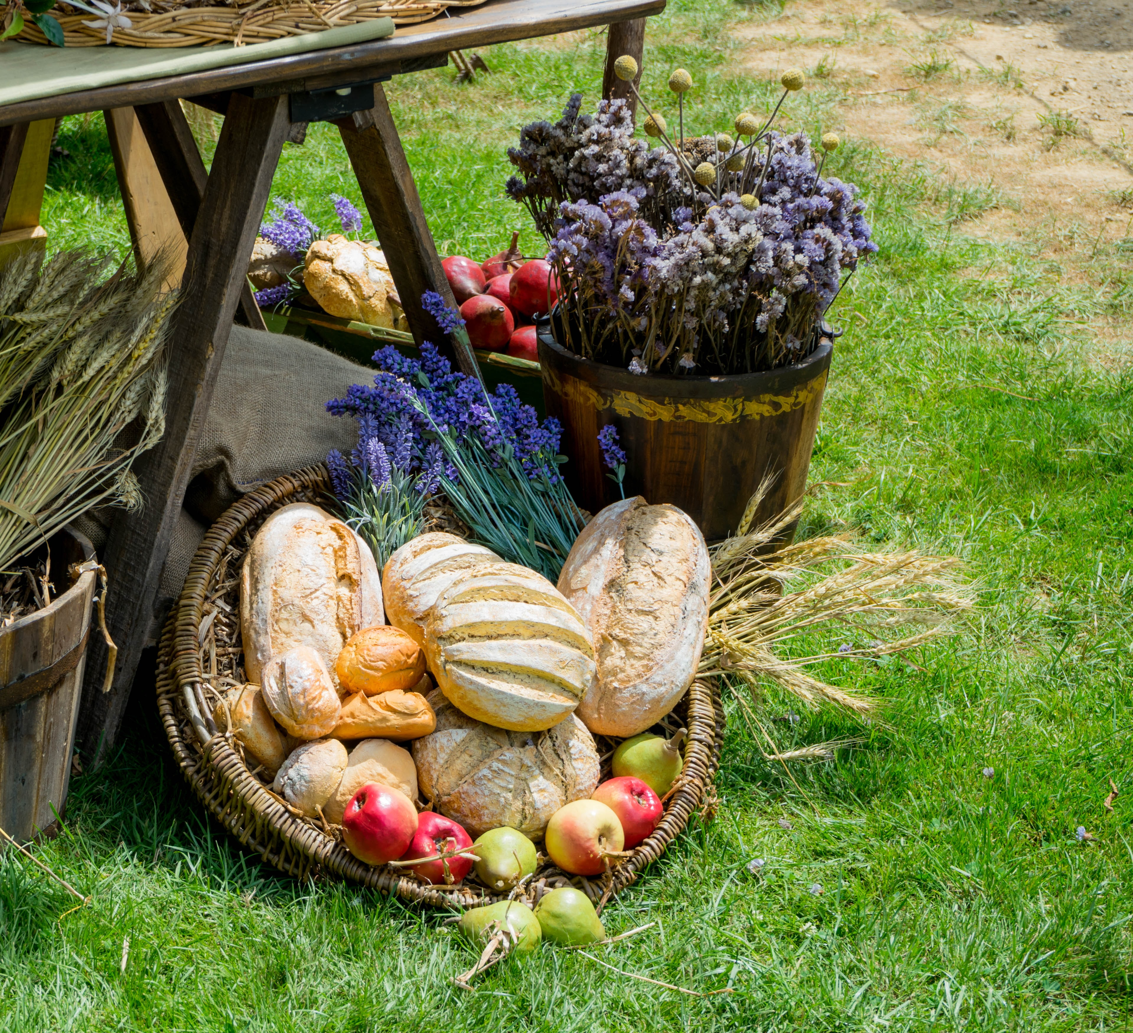 bread and fruits on tray near lavender flowers