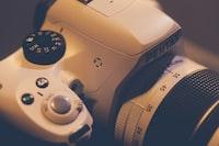 focus photography of white Pentax DSLR camera