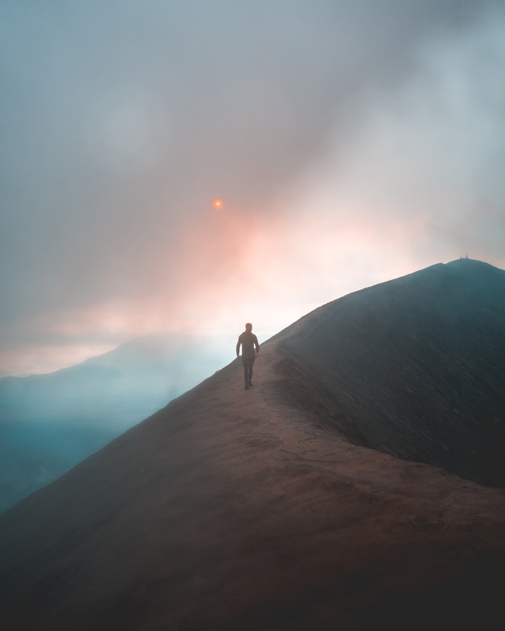 man walking on hill
