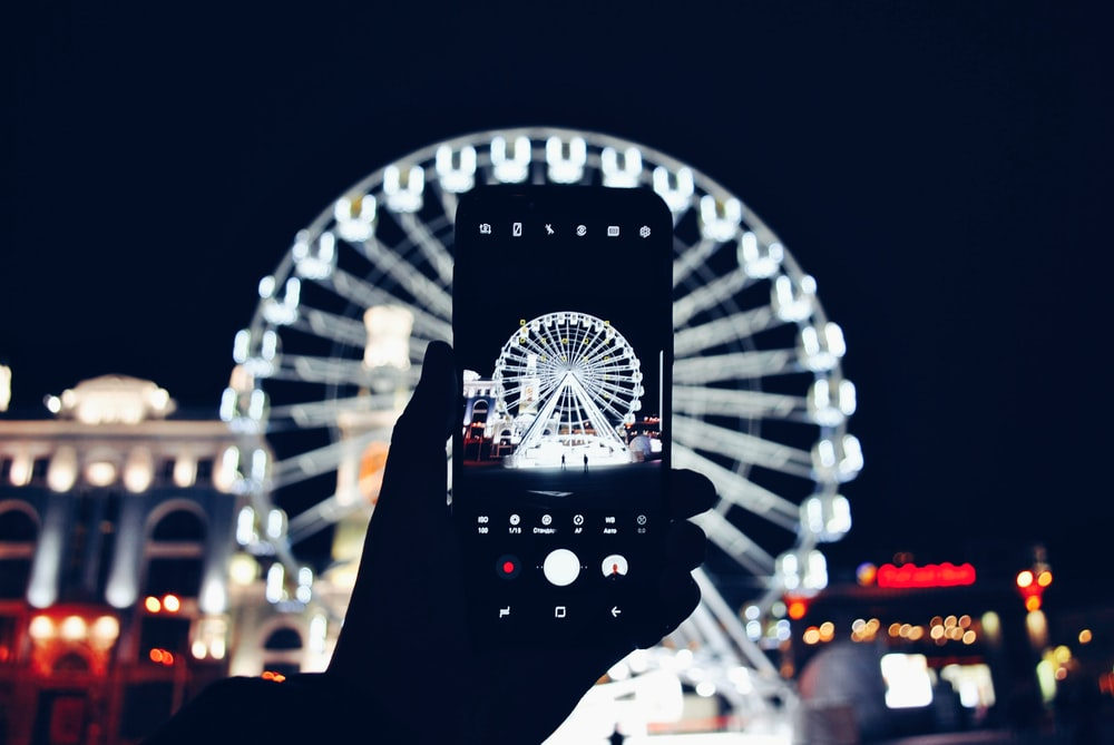 lighted ferris wheel at night