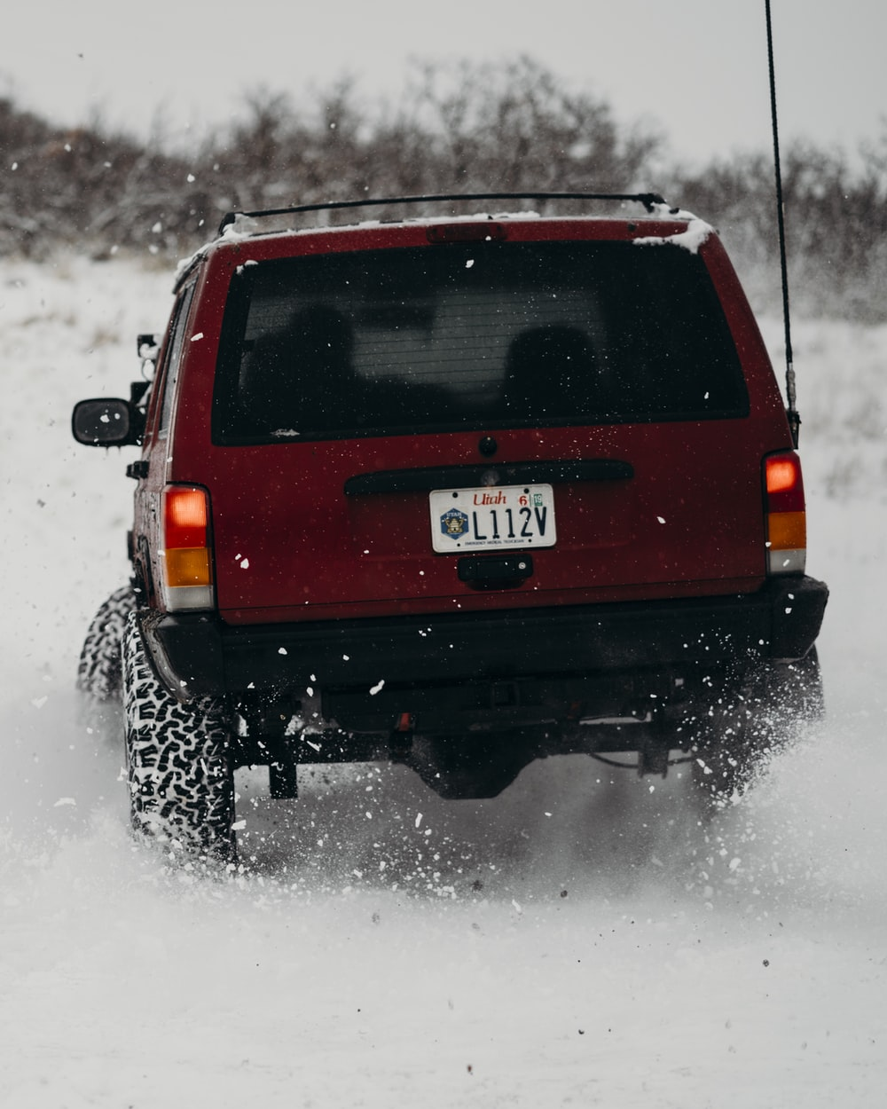 red SUV on ice covered tundra