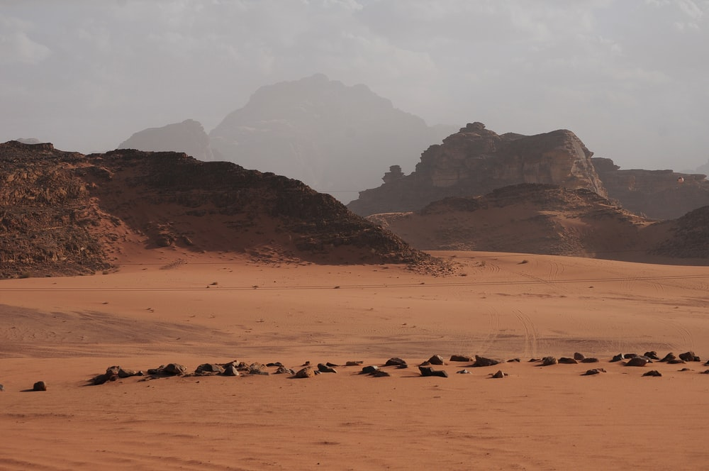 brown desert bounded by hills
