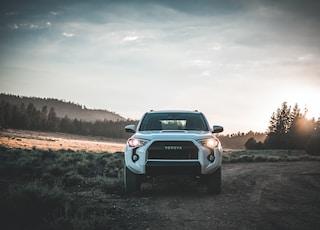parked white Toyota vehicle