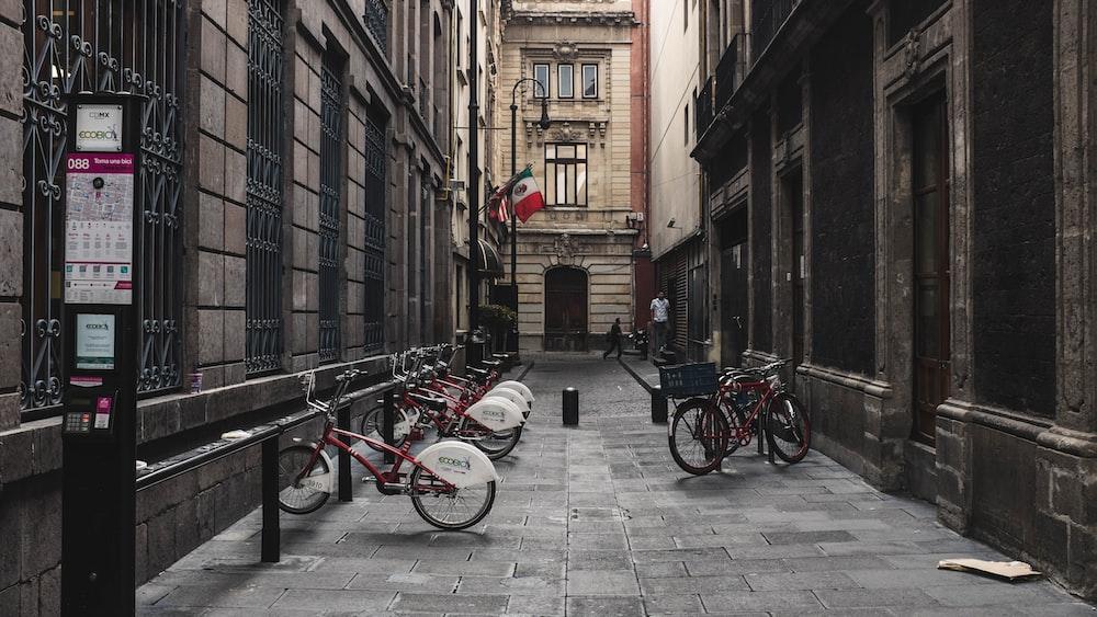 bikes between buildings during daytime