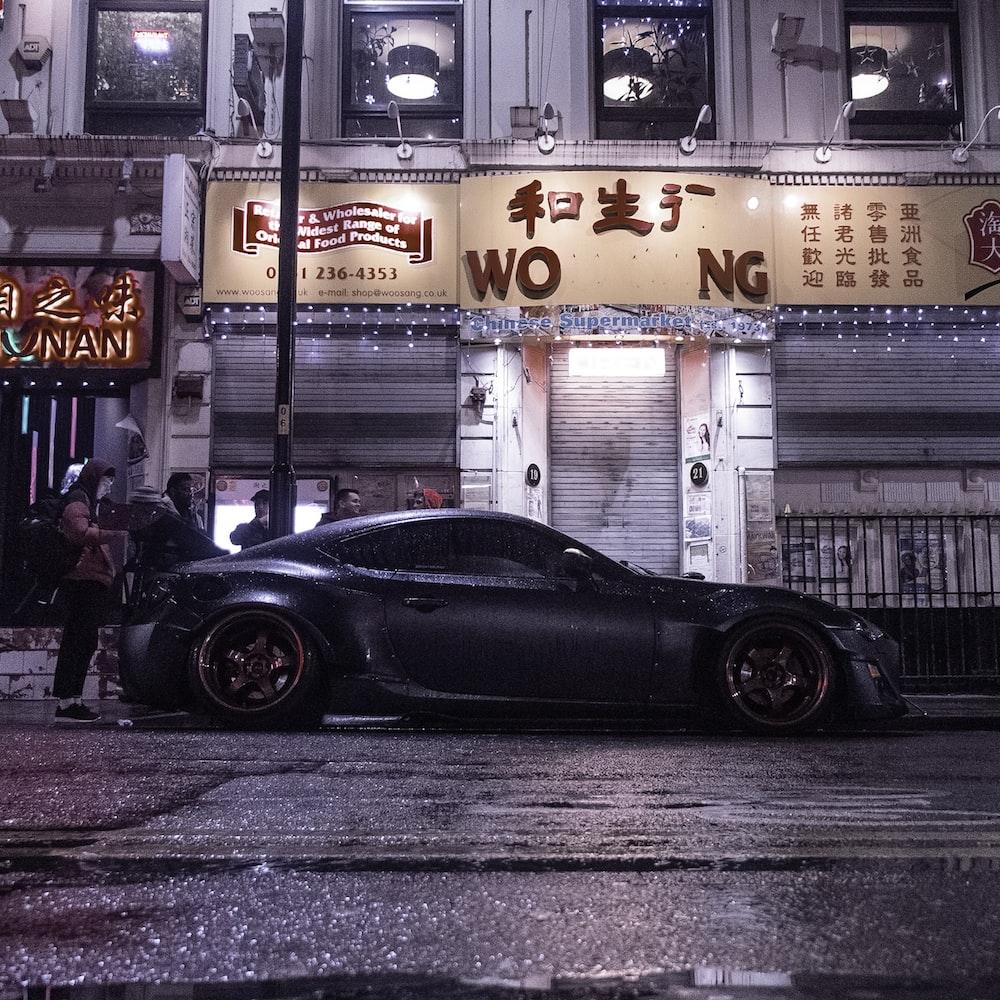 black luxury car on road
