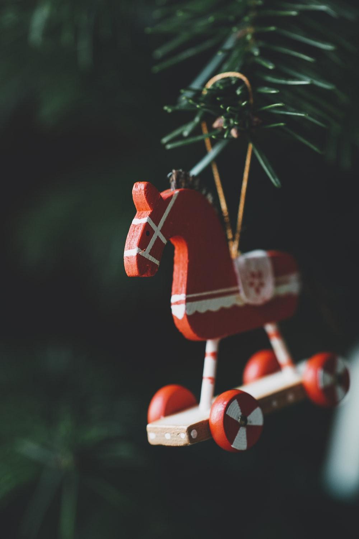 orange and white horse christmas tree ornmaent