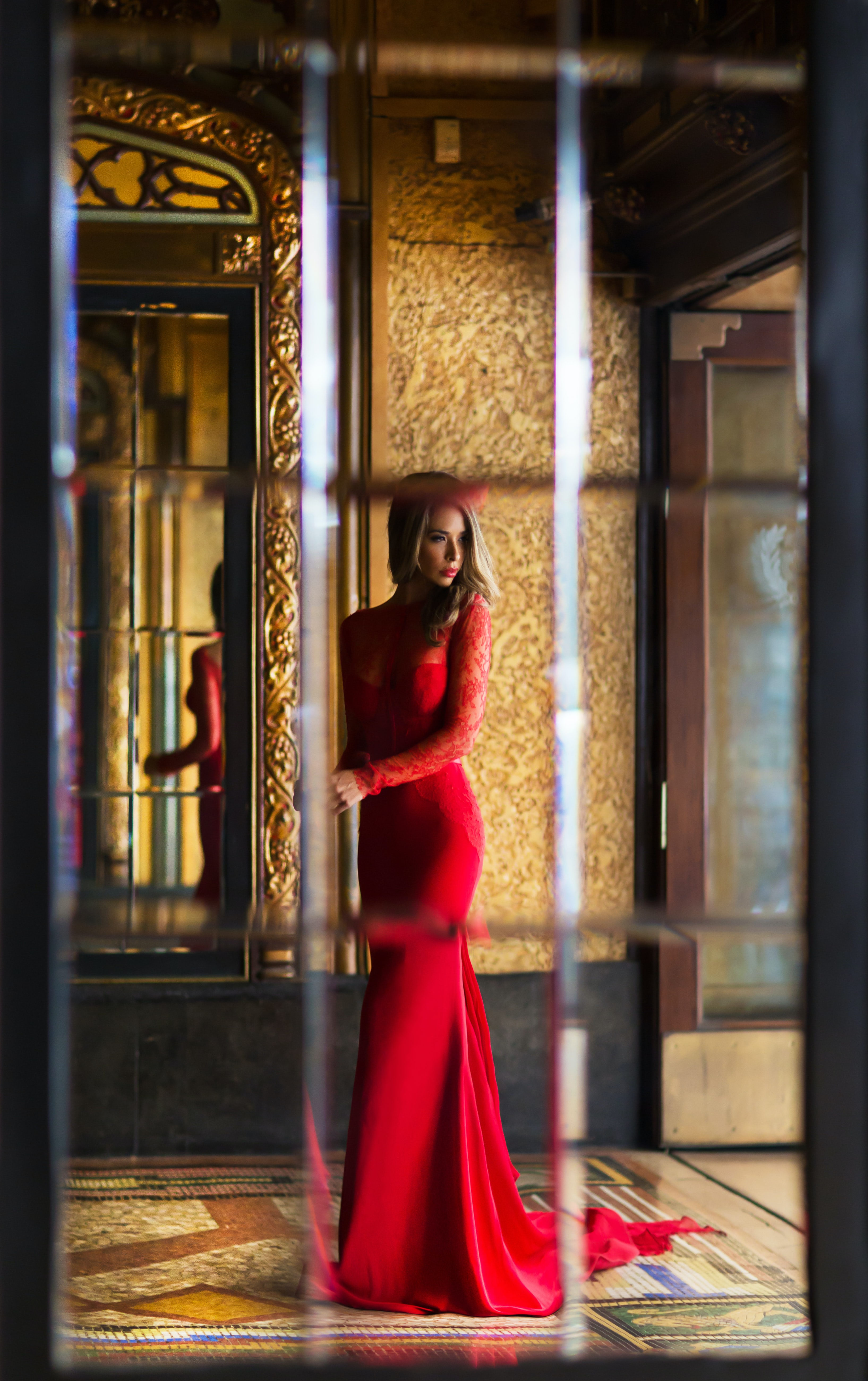 woman wearing red long-sleeved bodycon dress