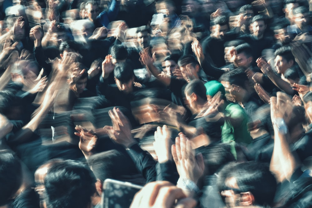 crowding people on focus photography