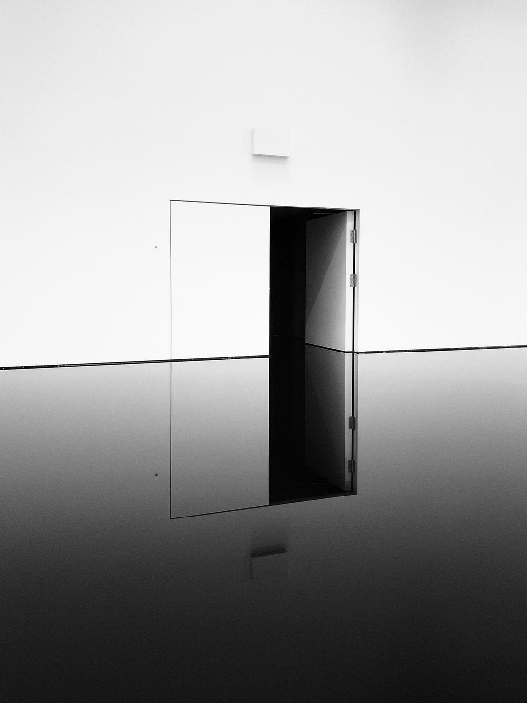 I took this photo when I visited Richard Wilson's 20:50 at The Hayward Gallery in London. The still, deep black engine oil contrasts the surrounding gallery wall, and I liked how the door's full height is recreated by its own reflection.