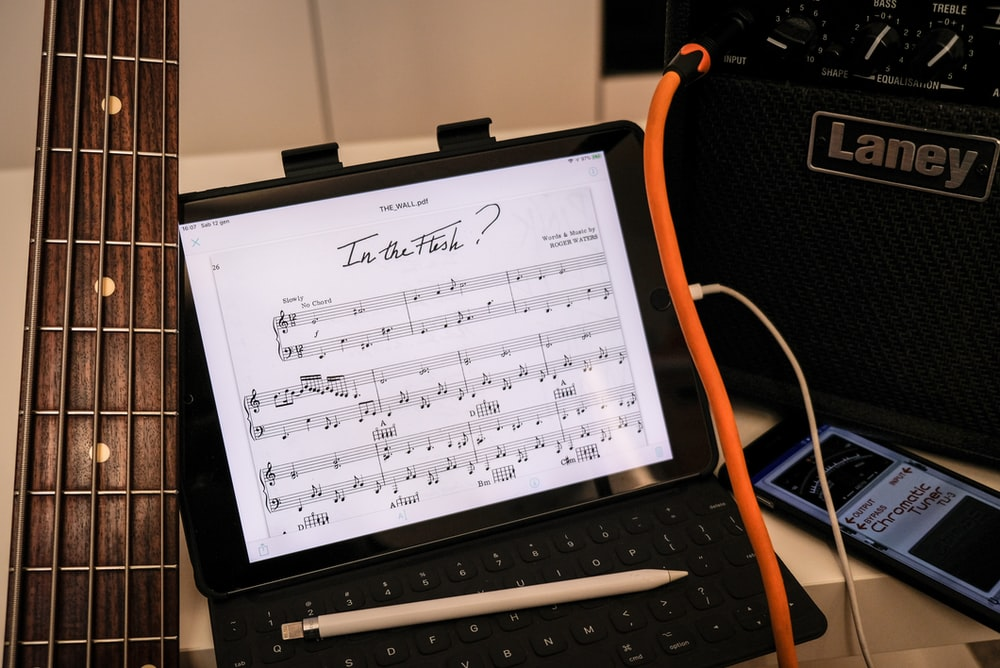 musical note on black laptop computer