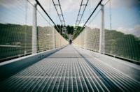 gray metal bridge under blue sky