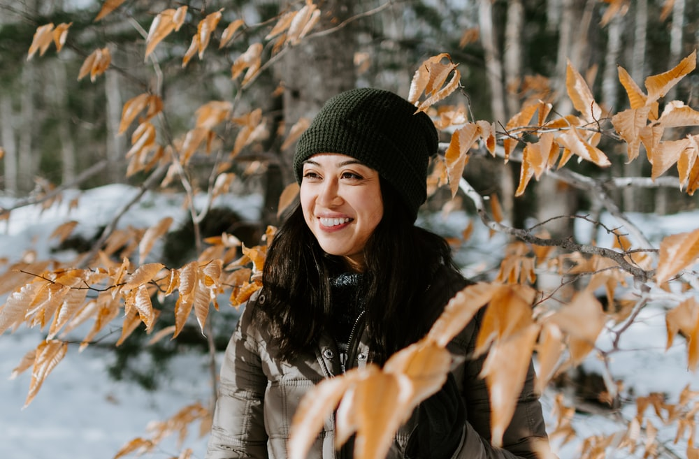 woman in gray bobble jacket smiling