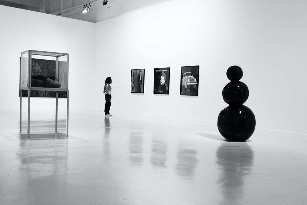 person standing and watching portraits
