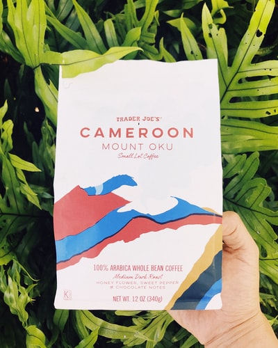 person holding Trader Joe's cameroon mount oku paper