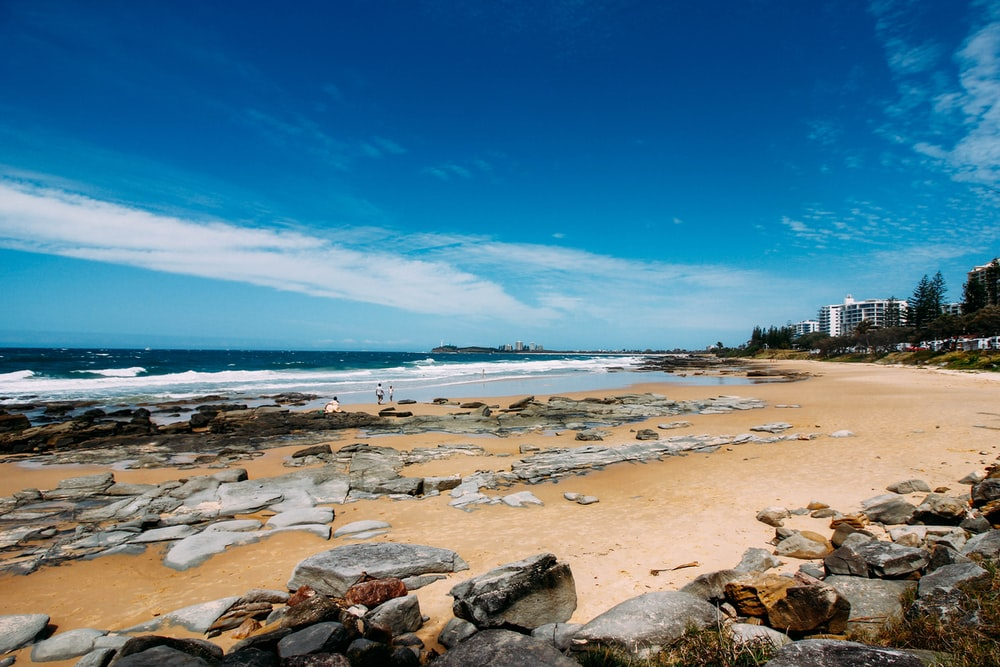 rocky shore under clear blue sky during daytime