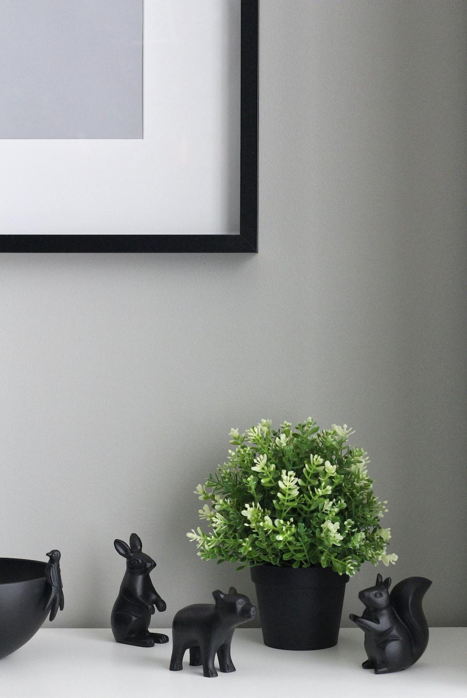 green indoor plants near ceramic rabbit figurine