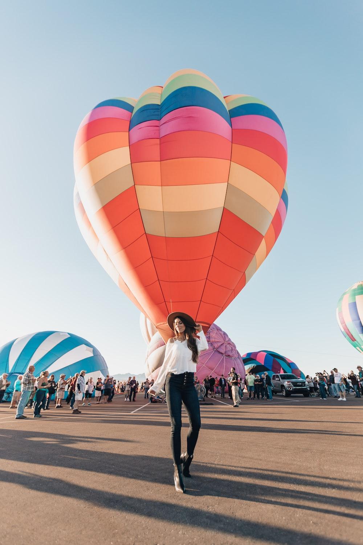woman standing near hot air balloon during daytime