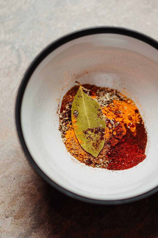 red chili powder on white bowl