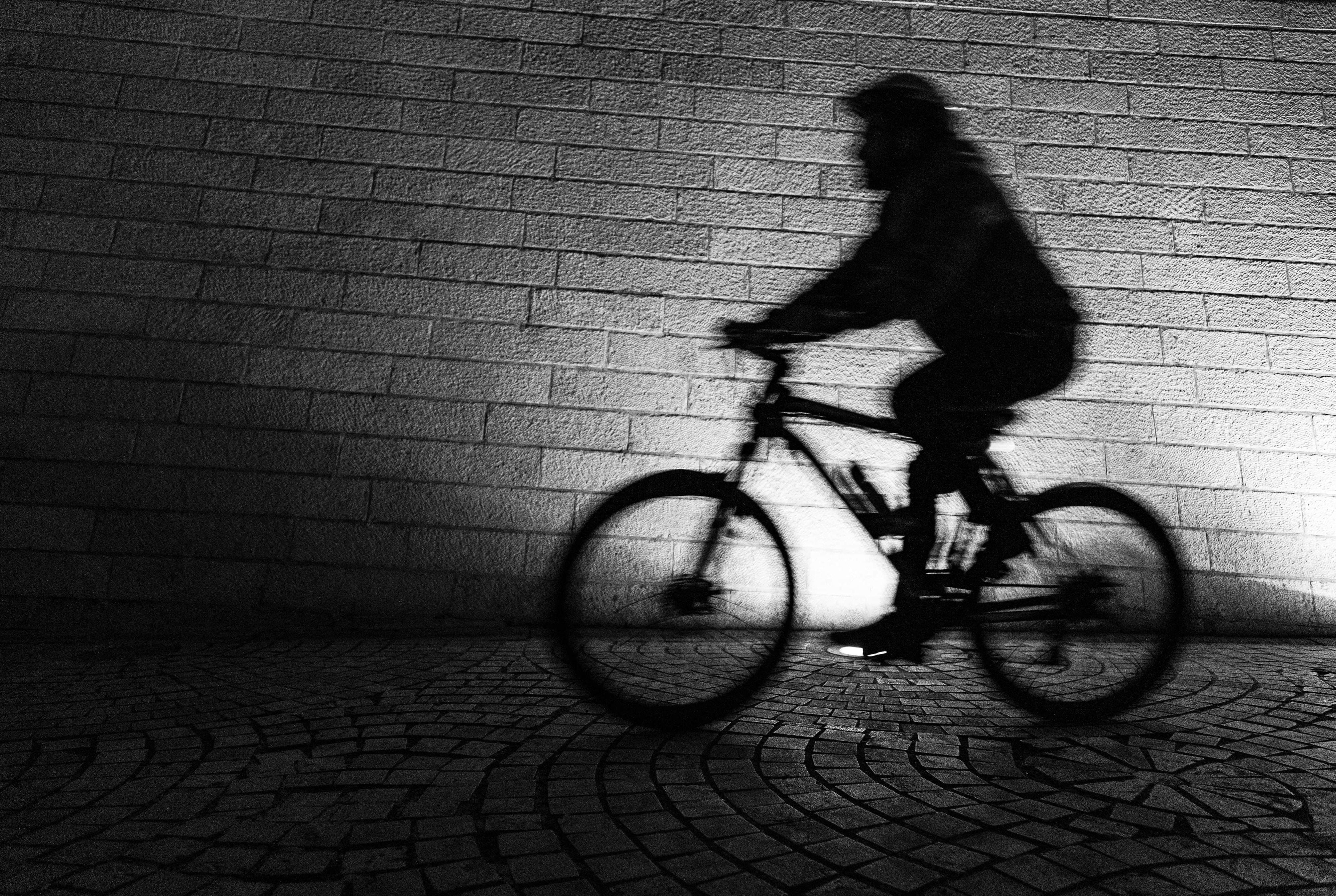 silhouette of biker inside tunnel