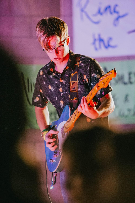 man playinh guitar