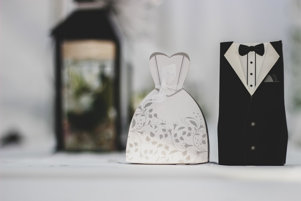 white and black groom and bride dress and suit decor