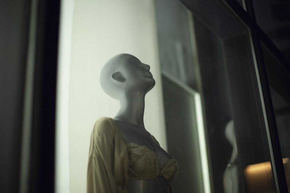 mannequin wearing yellow cardigan