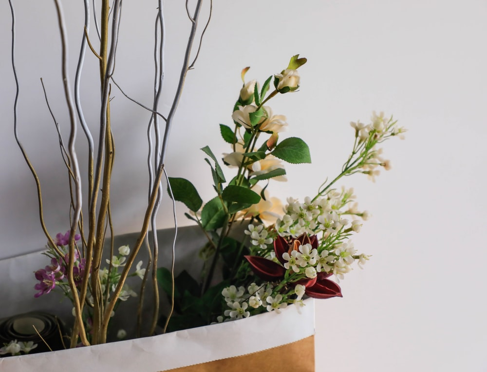 assorted flowers in shopping bag