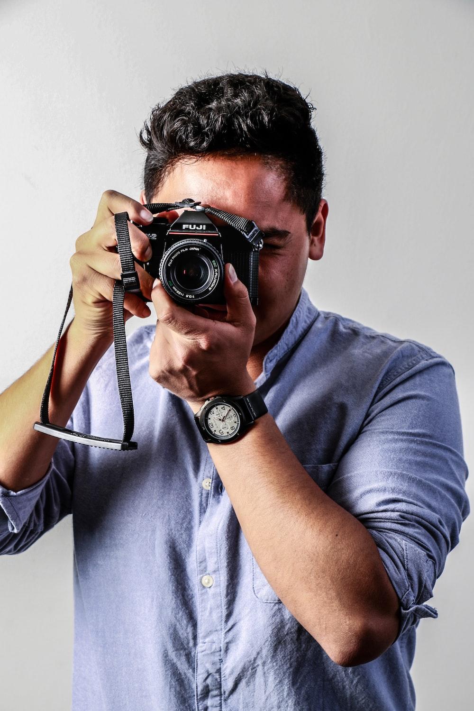 man holding camera \