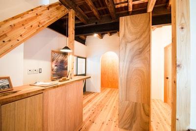 brown wooden desk beside palnk