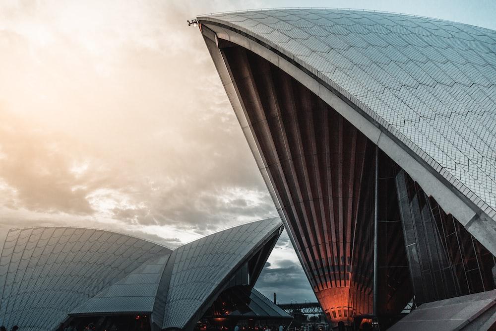 Sydney Opera under white clouds