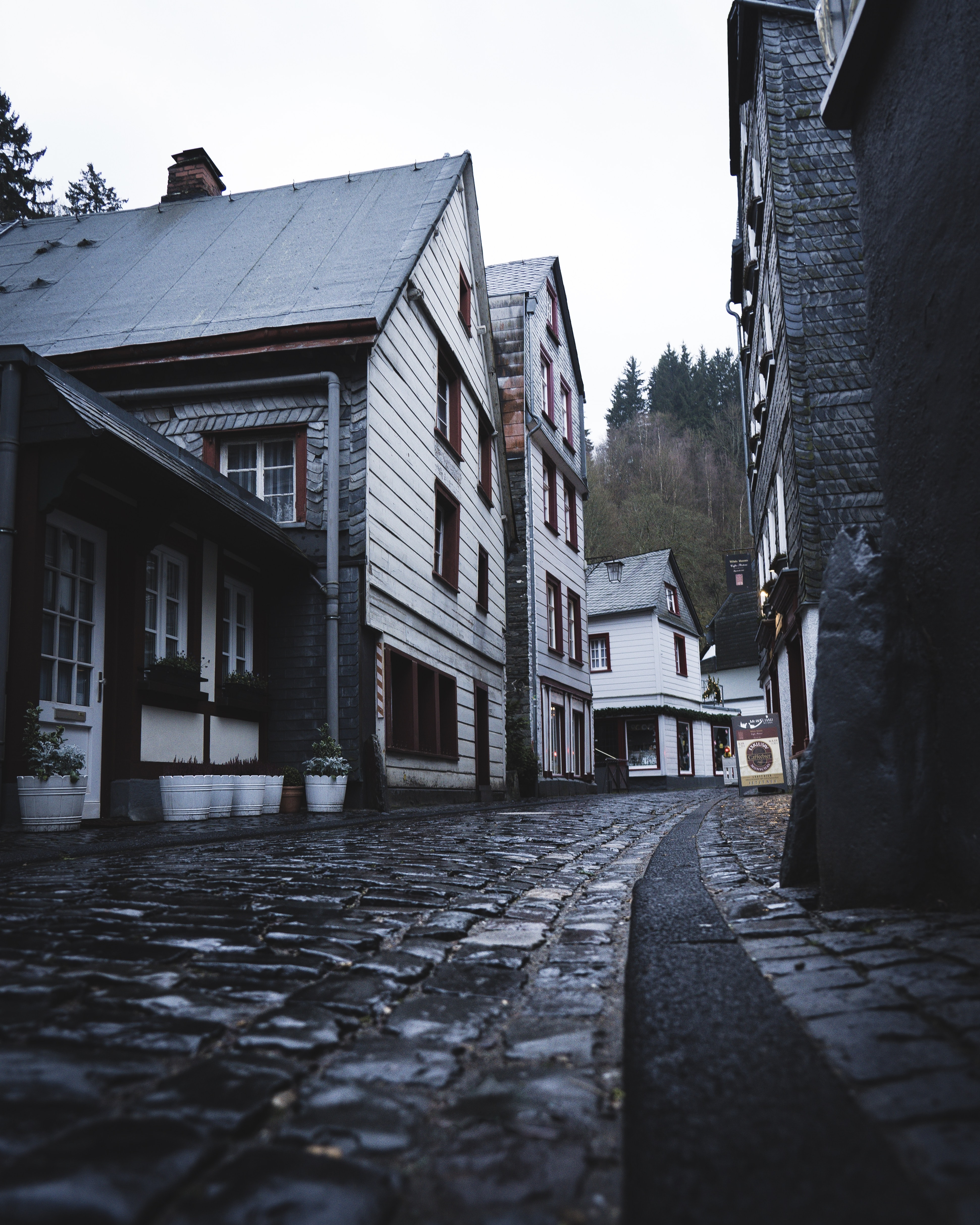 empty narrow street during daytime