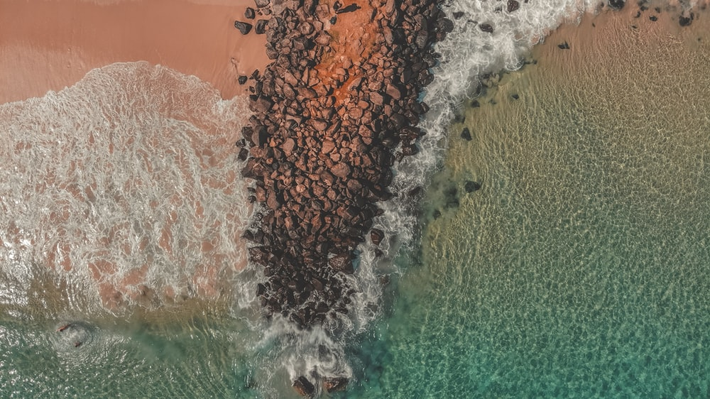 sea water crashing in beach sand