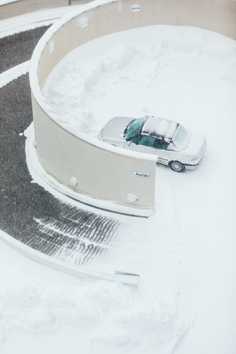 white car parked on snow