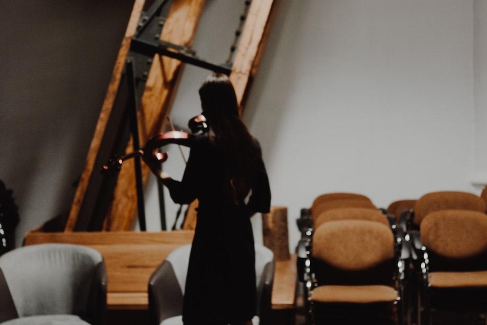 woman standing near chair