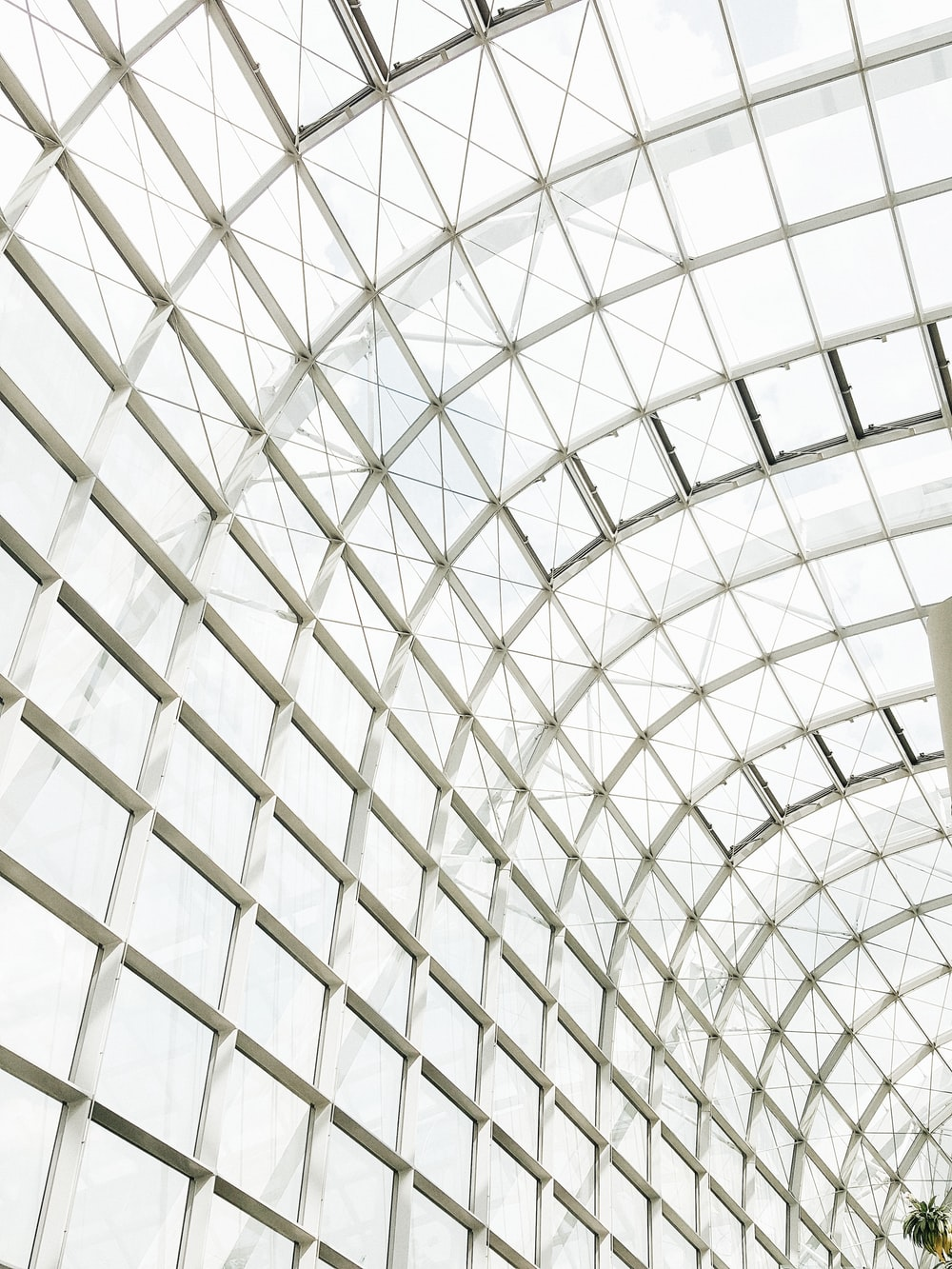 low angle photography of clear glass ceiling