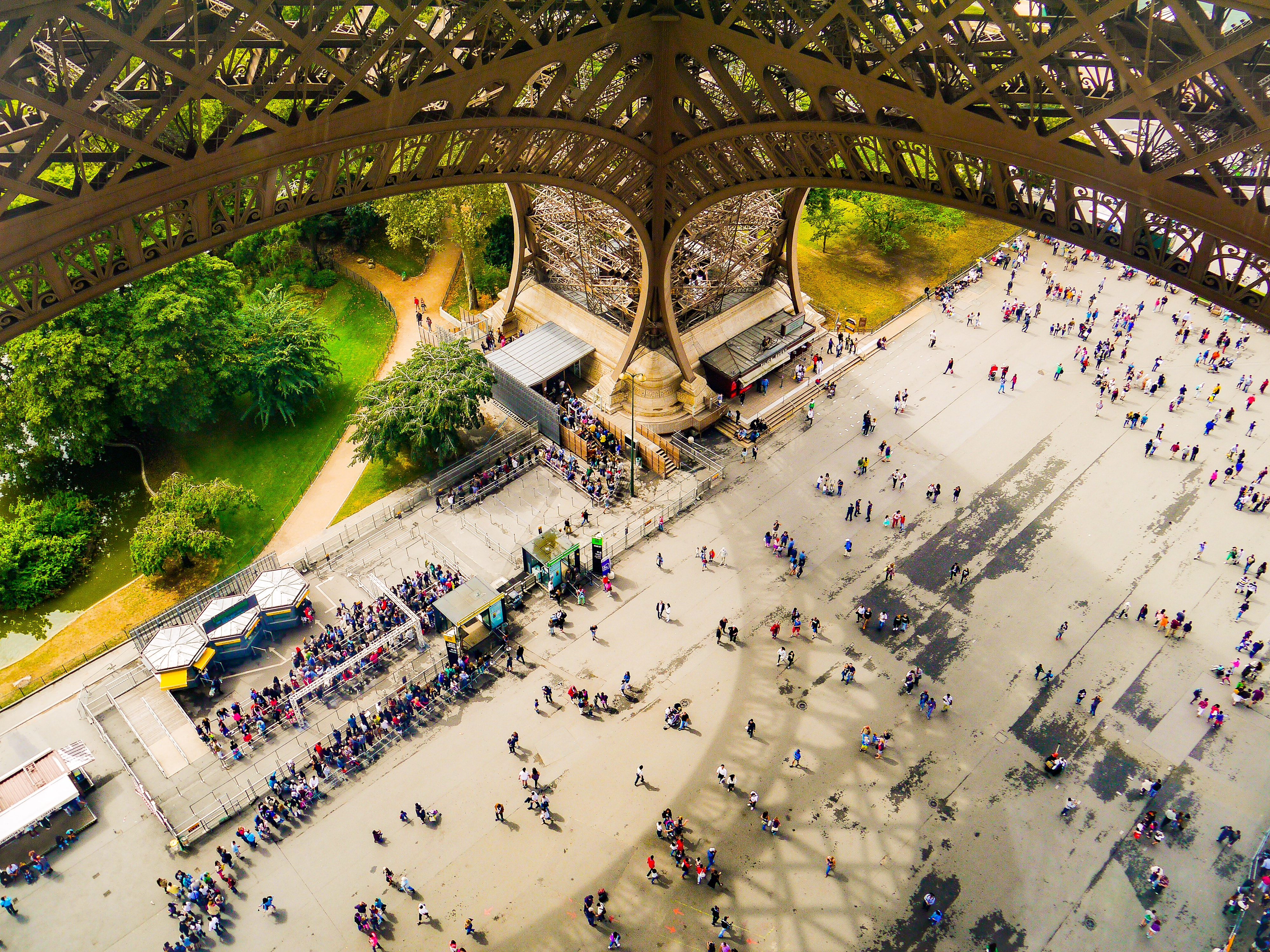 low-angle photography of people under Eiffel tower during daytime