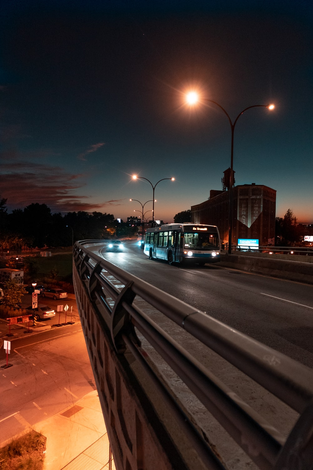 bus on road during nighttime
