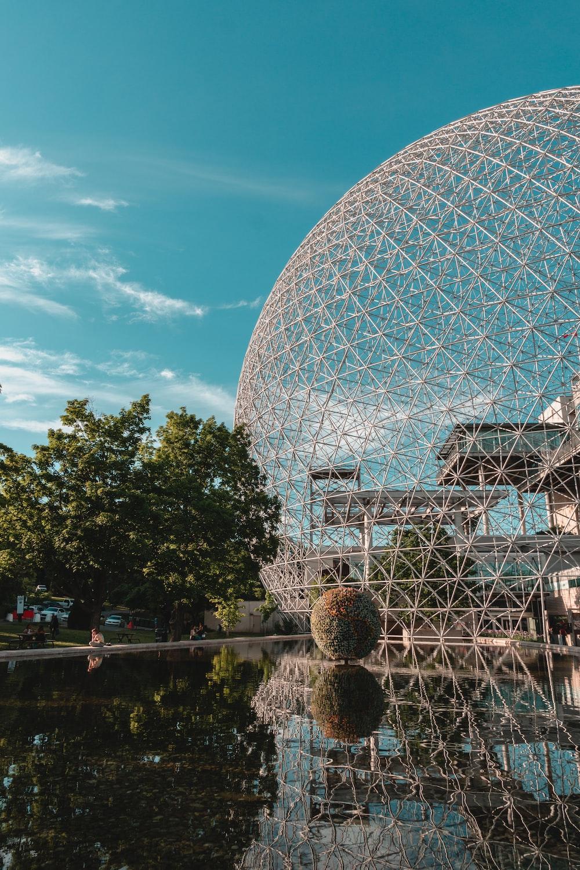 gray stainless steel globe landmark under green skies