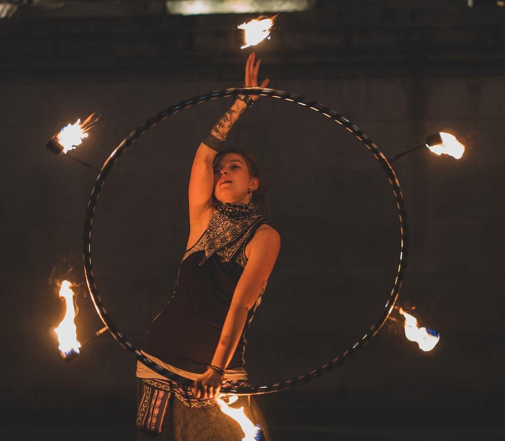 woman fire dancing at night