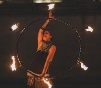 woman fire dancing at night