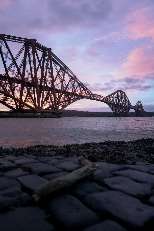 brown metal bridge over water