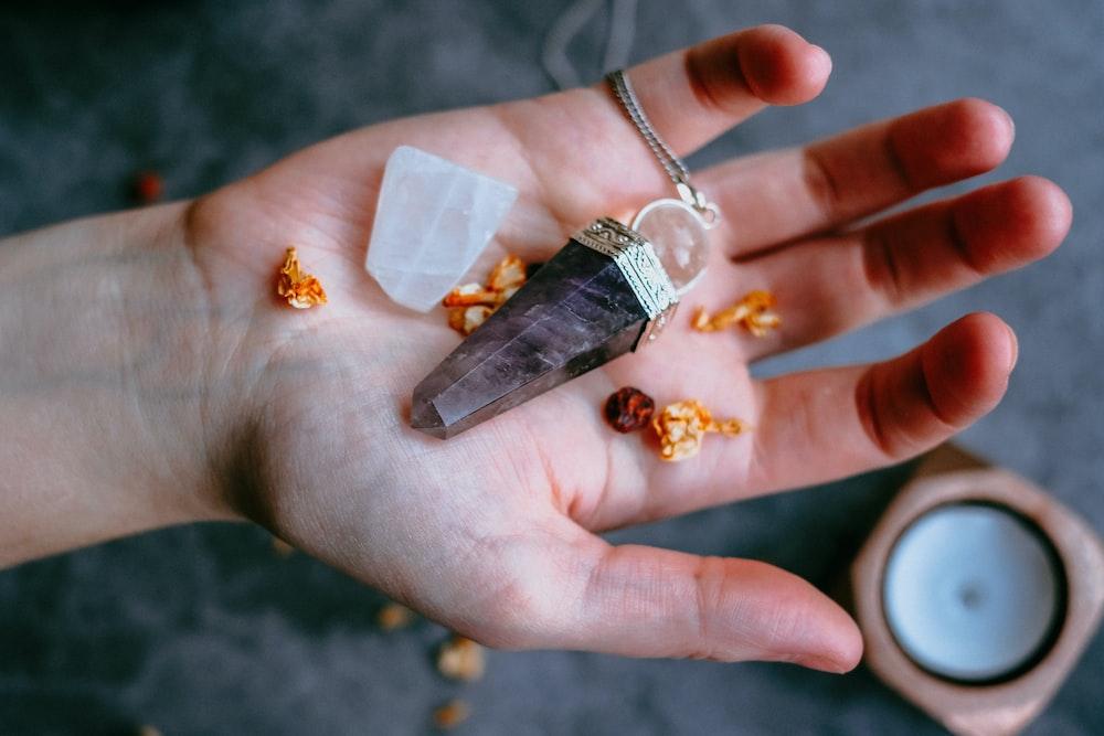 black pendant on palm