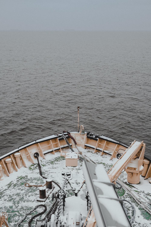 brown ship on sea