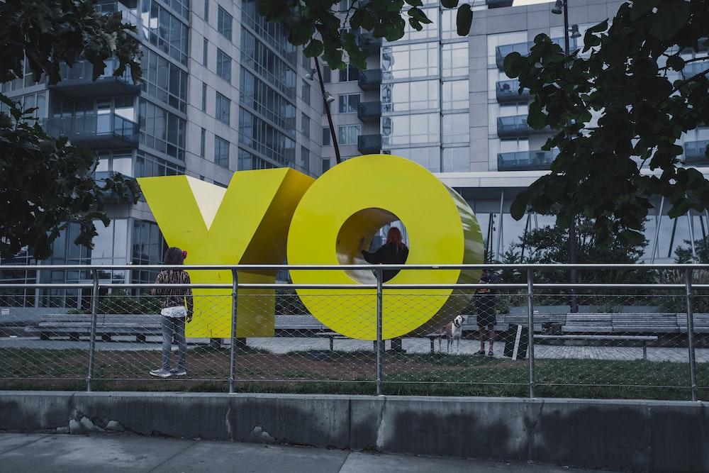 person standing near YO landmark